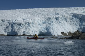 Iceberg-and-kayaker-300x199