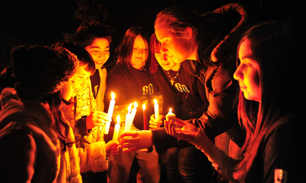 WWF supporters light candles for Earth Hour.