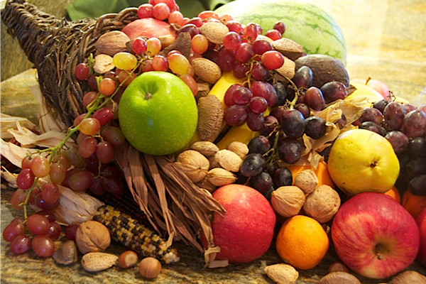 The horn of plenty or cornucopia—usually depicted overflowing with produce, flowers or nuts—symbolizes abundance and nourishment. In North America, the horn is particularly associated with the Thanksgiving holiday. ©Sally Oh, flickr