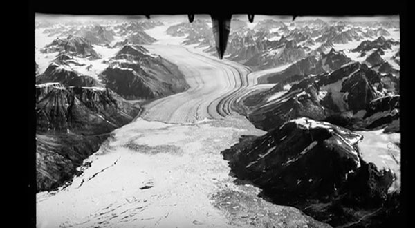 "The 1930s photos were captured with a rotating camera flown in an open hydroplane, the tail of which you can see in the upper center. ©From the video ""Glaciers Lost in Time"" by Nature Video"