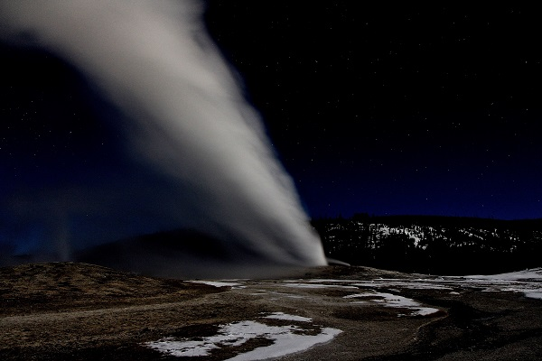 Nighttime at Old Faithful in Yellowstone National Park, without another soul in sight.
