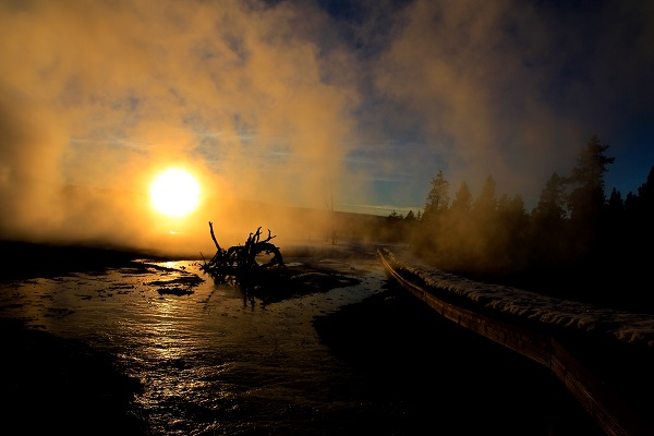 The mystical Fountain Paint Pots and Geyer Basin at sunset in Yellowstone National Park.