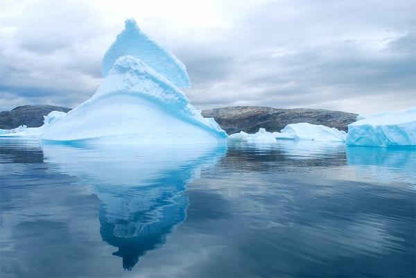"""Cloudy skies in Sermilik Fjord's """"iceberg graveyard"""" lend a mysterious quality to the Arctic landscape."""