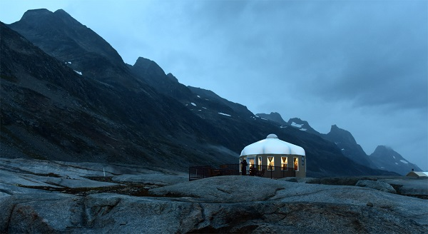 A refuge from the storm: A cozy evening spent in the lounge yurt for an evening film, safe from the elements outside.