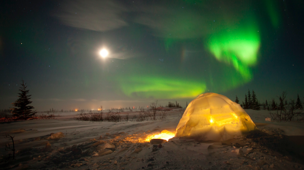 Igloo with northern lights in the background