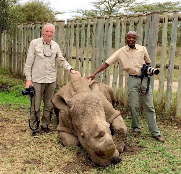 Natural Habitat Adventures Expedition Leader Paul Kirui with Sudan, the last male northern white rhino