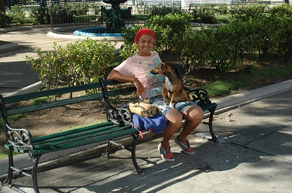 A Cuban lady and her dog out for their morning constitutional