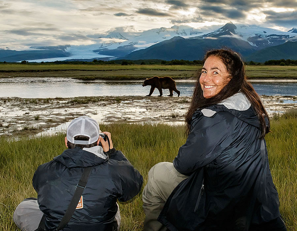 Wendy Klausner Komarnitsky with a wild bear in Alaska