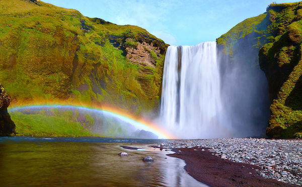 Waterfall with rainbow in Iceland.