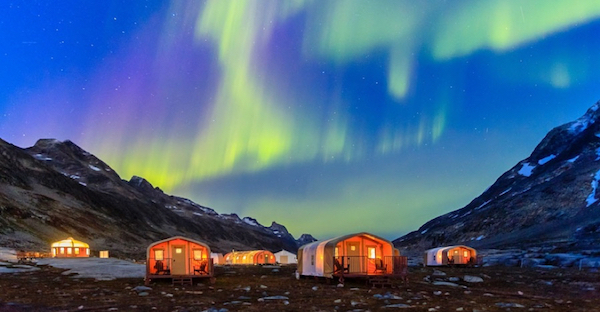 Base Camp Greenland with northern lights overhead.