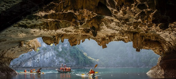 Kayaking down river in cave.