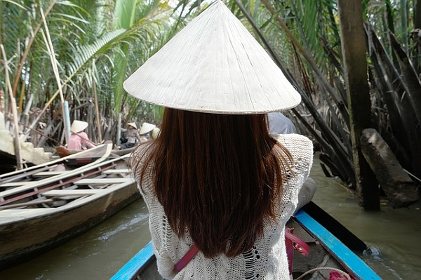 Girl traveling down Mekong River