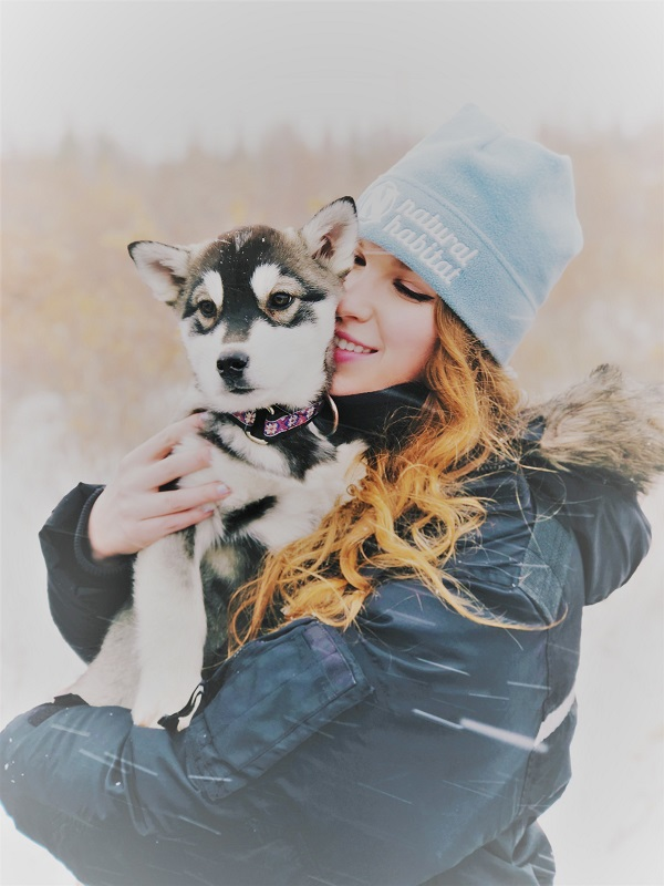 Emily Kautz with husky puppy in Churchill, Manitoba.