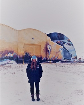 Emily Kautz at the Polar Bear mural in Churchill, Manitoba.