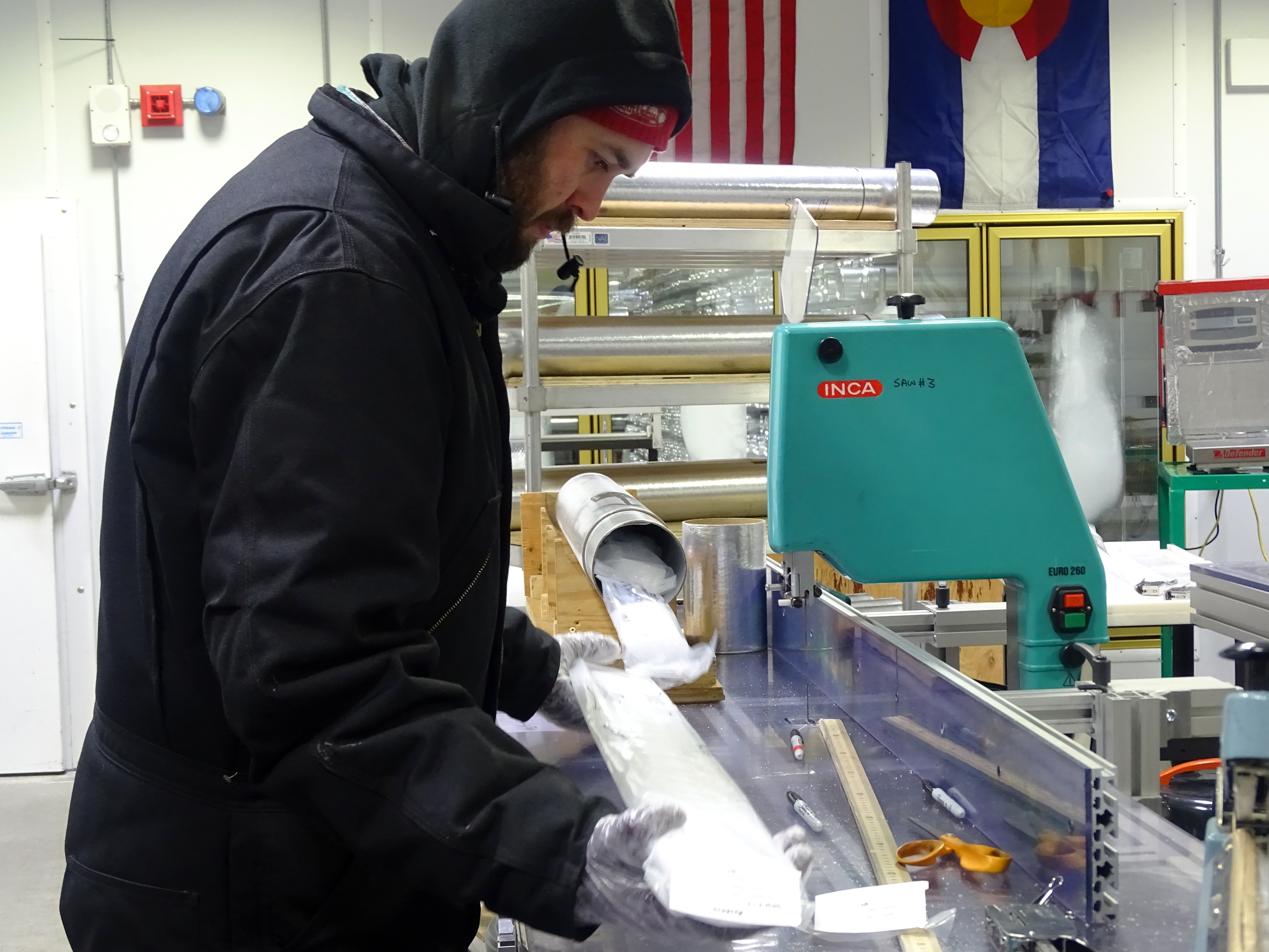 cutting ice cores for study, NSF Ice Core Laboratory