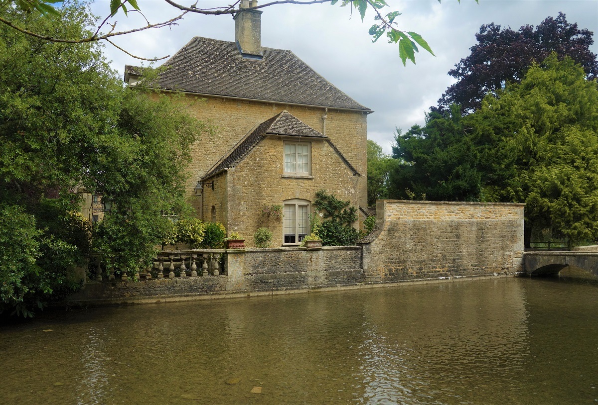 A house on the water in the Cotswolds, England.
