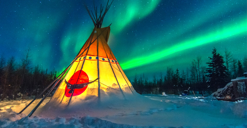 Teepee in front of the northern lights in Churchill