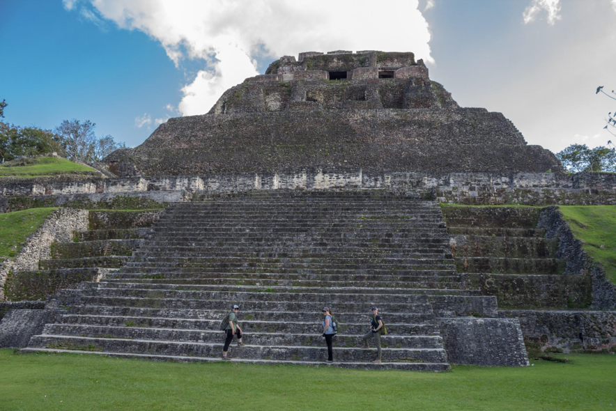 Two travelers and me beginning the climb up the ancient steps to Xunantunich El Castillo temple.