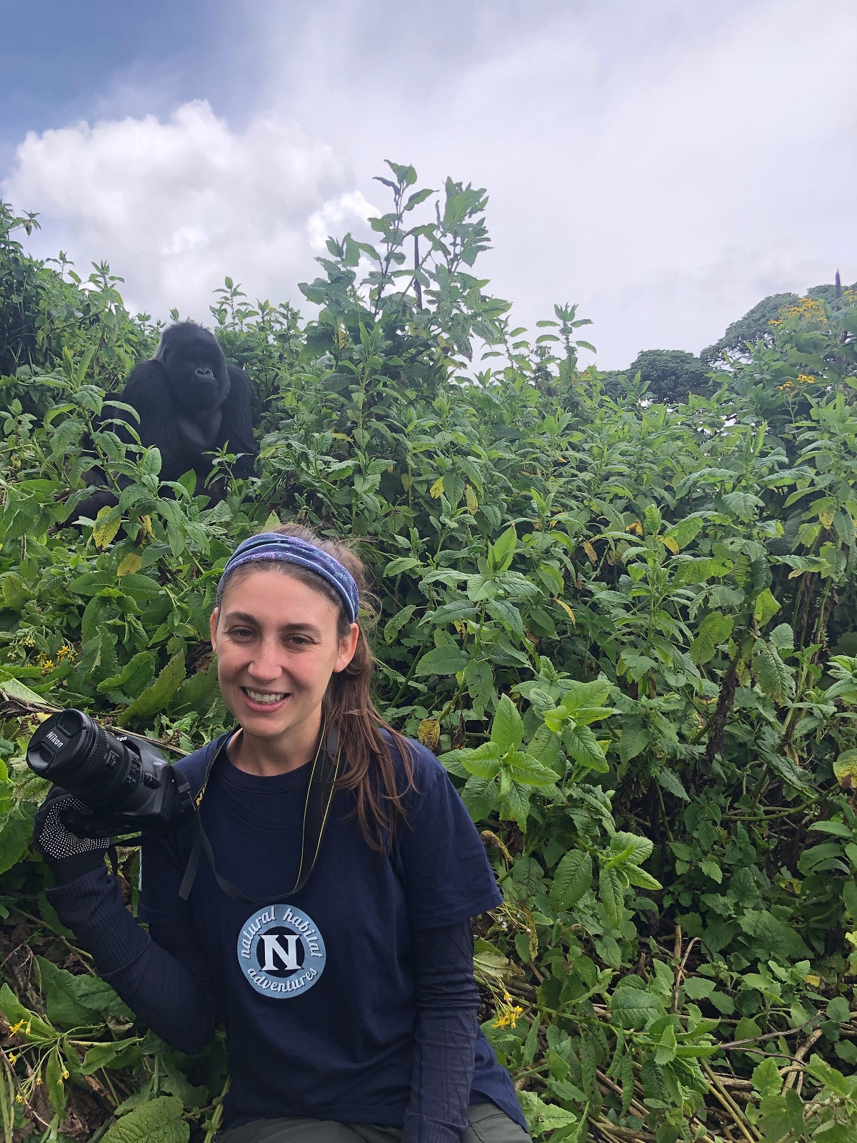 Girl with gorillas in Uganda on a Nat Hab safari.