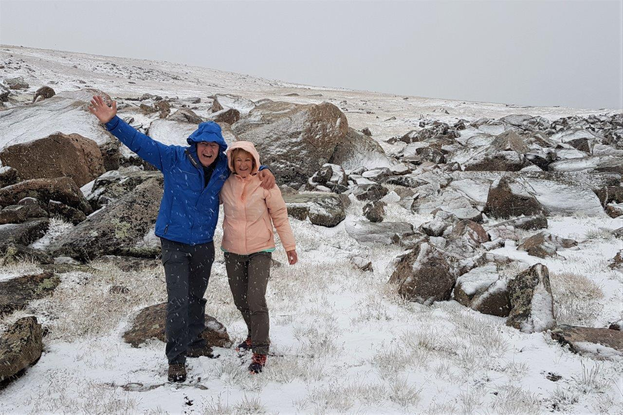 Nat Hab travelers pose in the snow in Yellowstone.