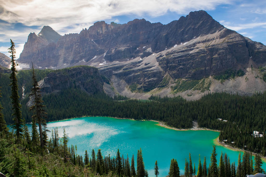 Towering mountains rise above turquoise lakes in Yoho National Park.