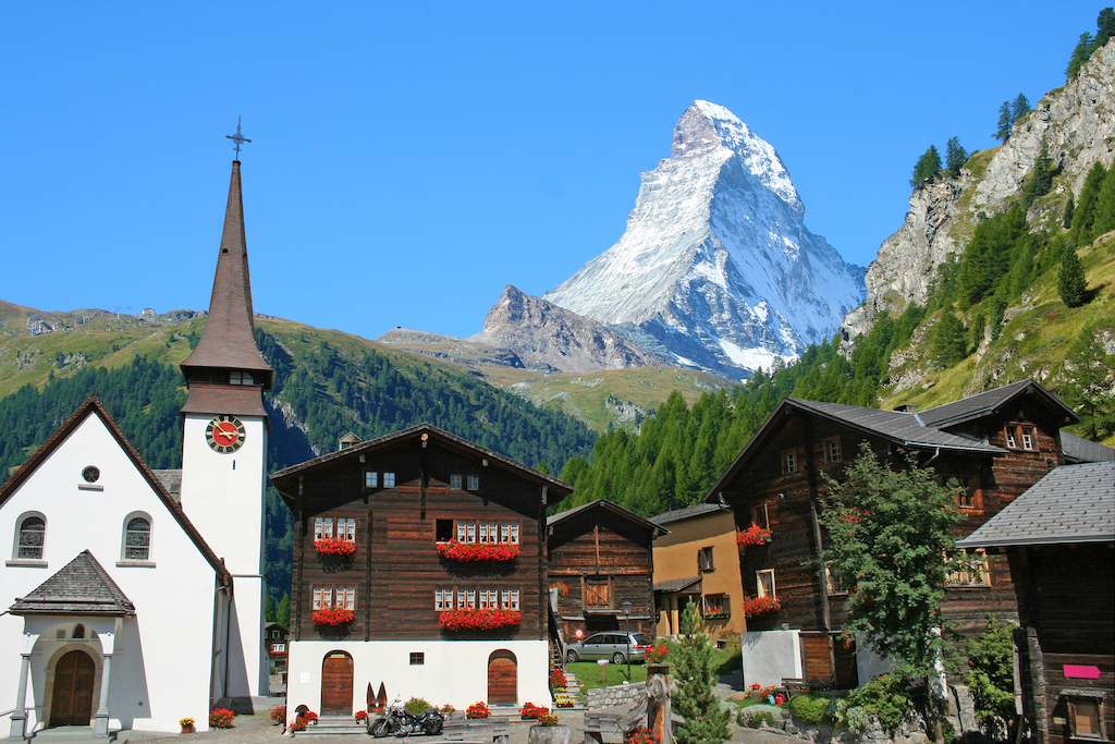 Nestled into the valley, Zermatt is a jewel of the Swiss Alps. The Matterhorn rises above the small village.